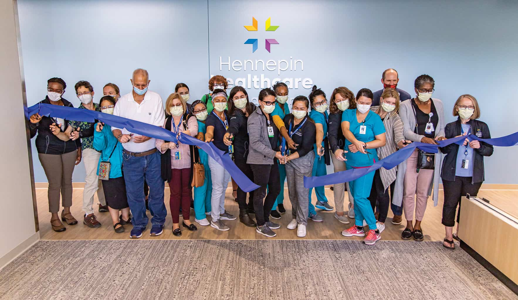 east lake clinic staff cutting ribbon at grand opening