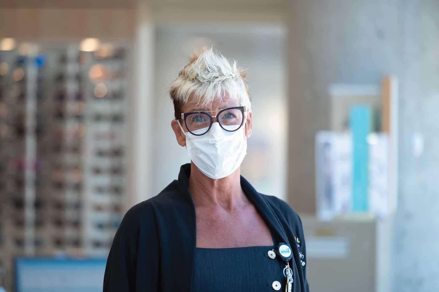eye clinic optical shop nurse with mask
