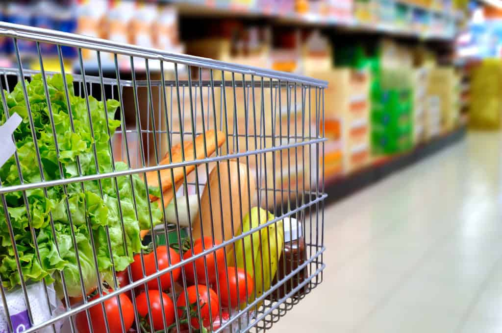 grocery cart with food in store