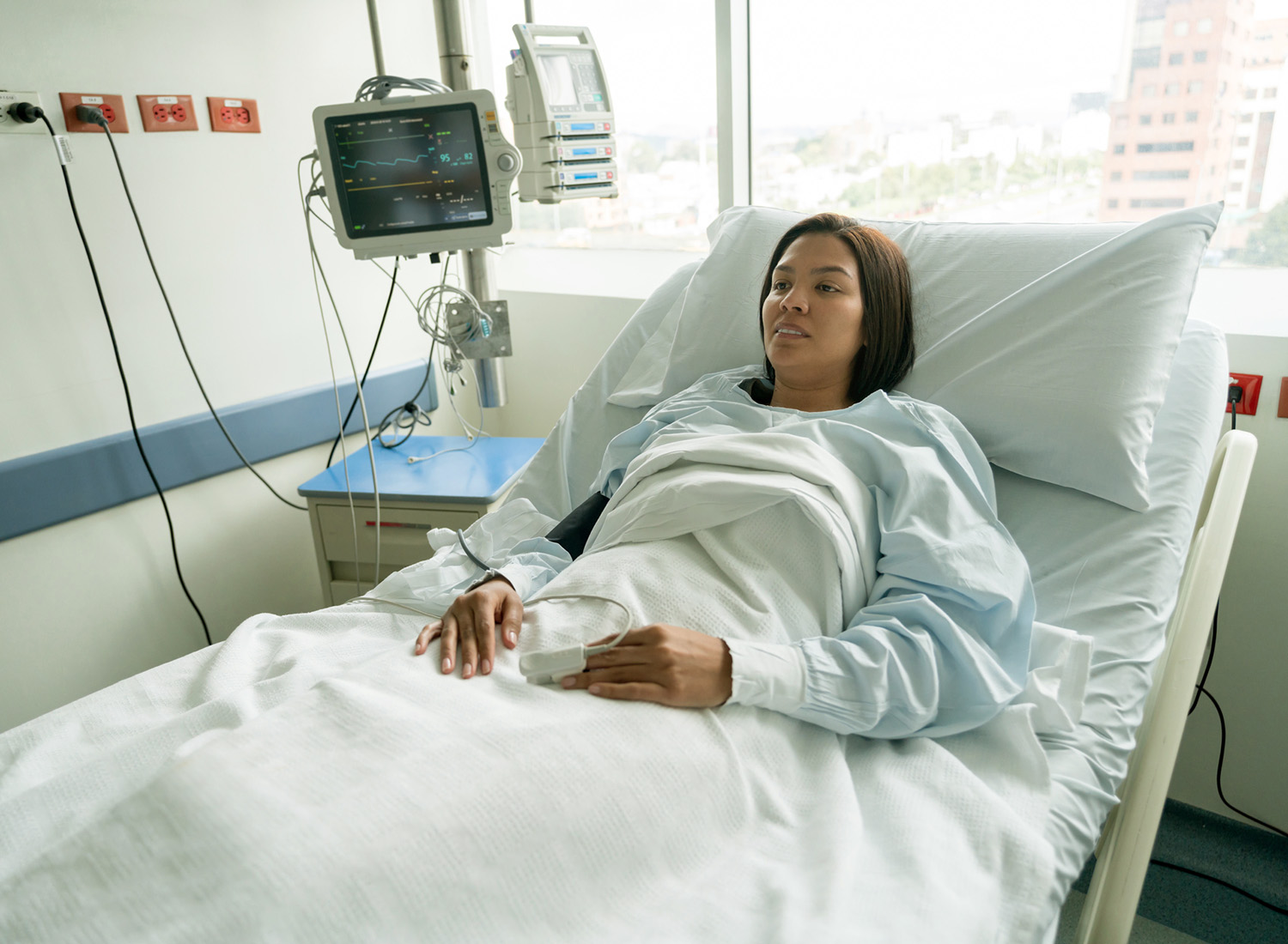 woman in hospital bed waiting for colonoscopy exam
