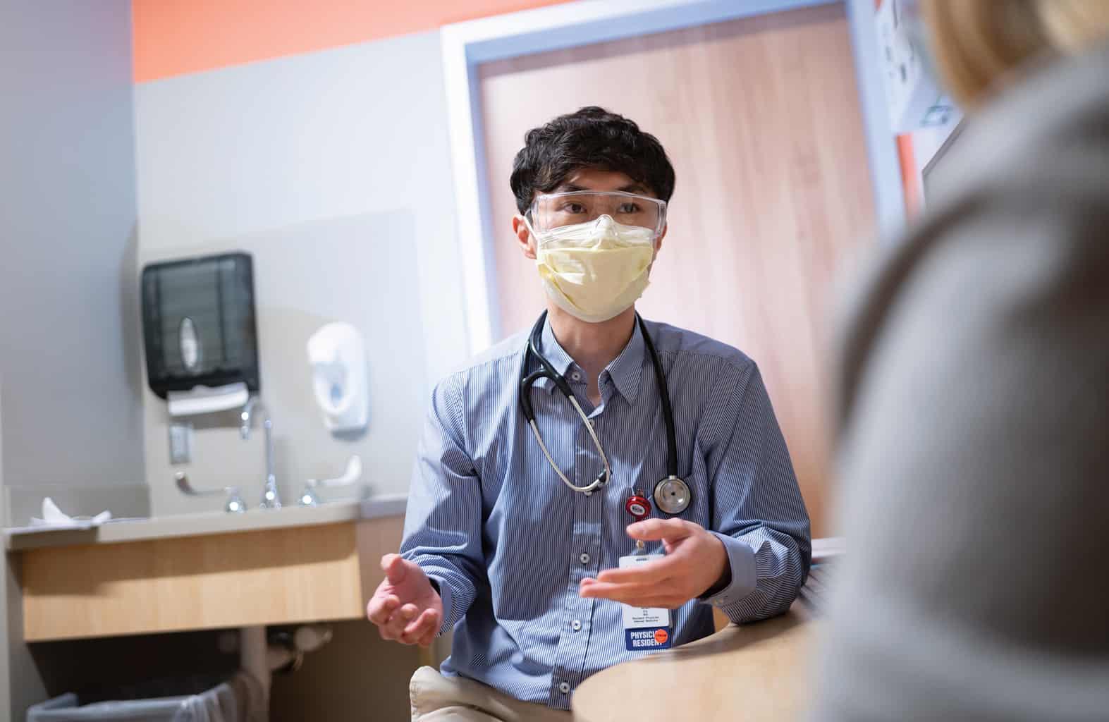internal medicine provider with patient