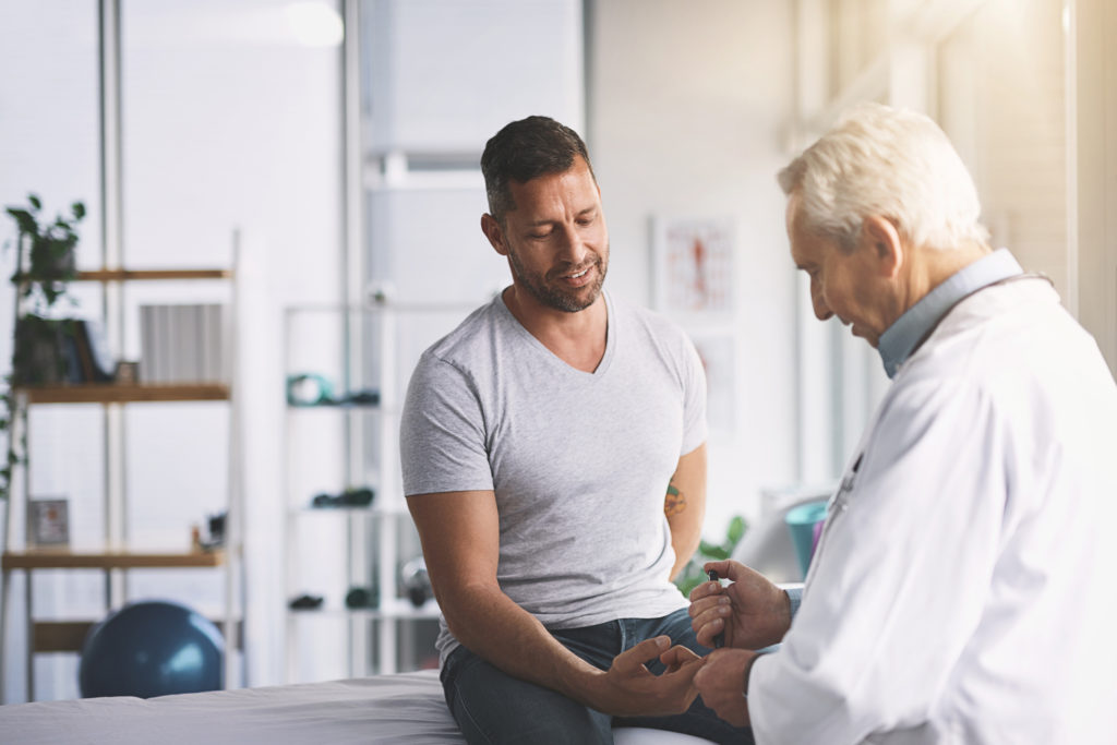 man in clinic with doctor