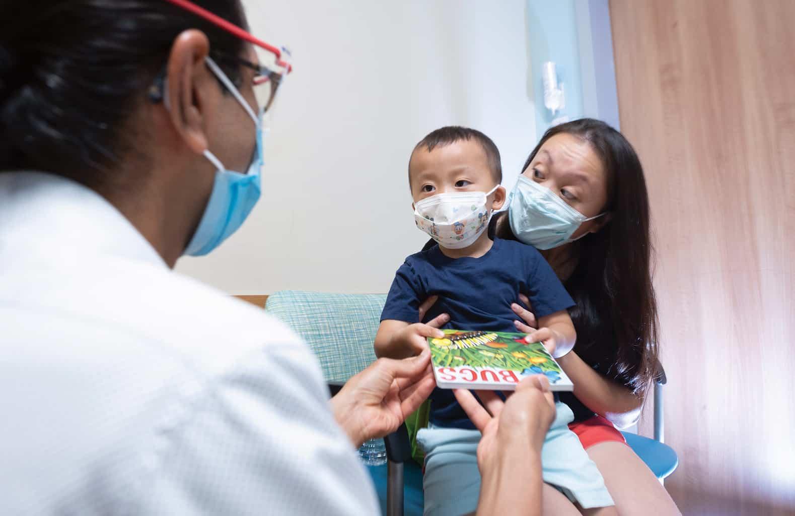 pediatrics mom child doctor in clinic