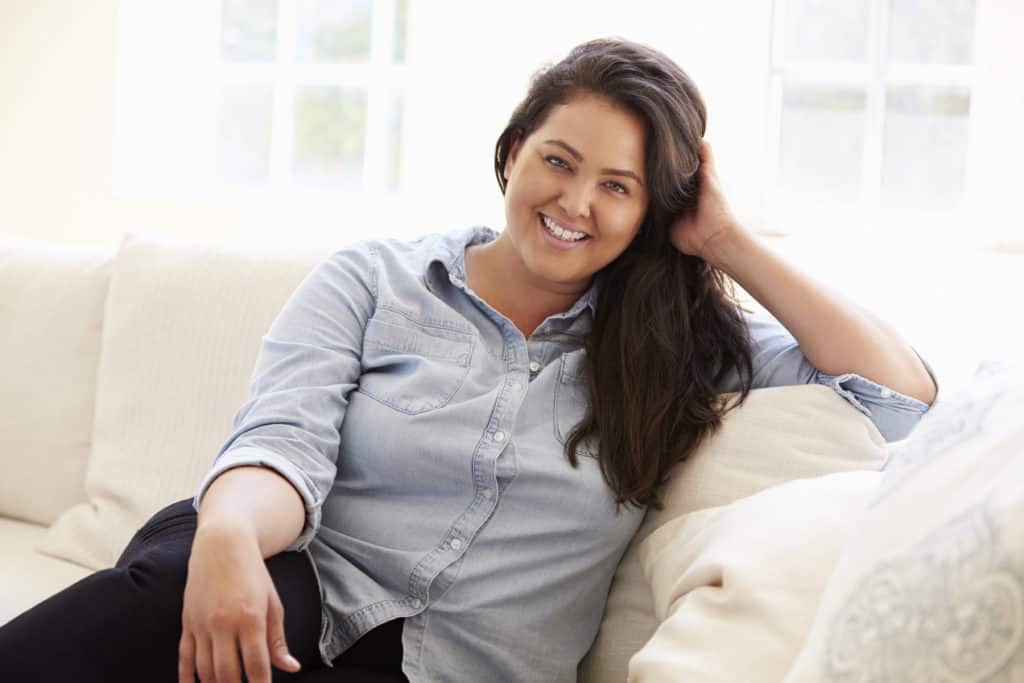 weight management woman sitting on couch