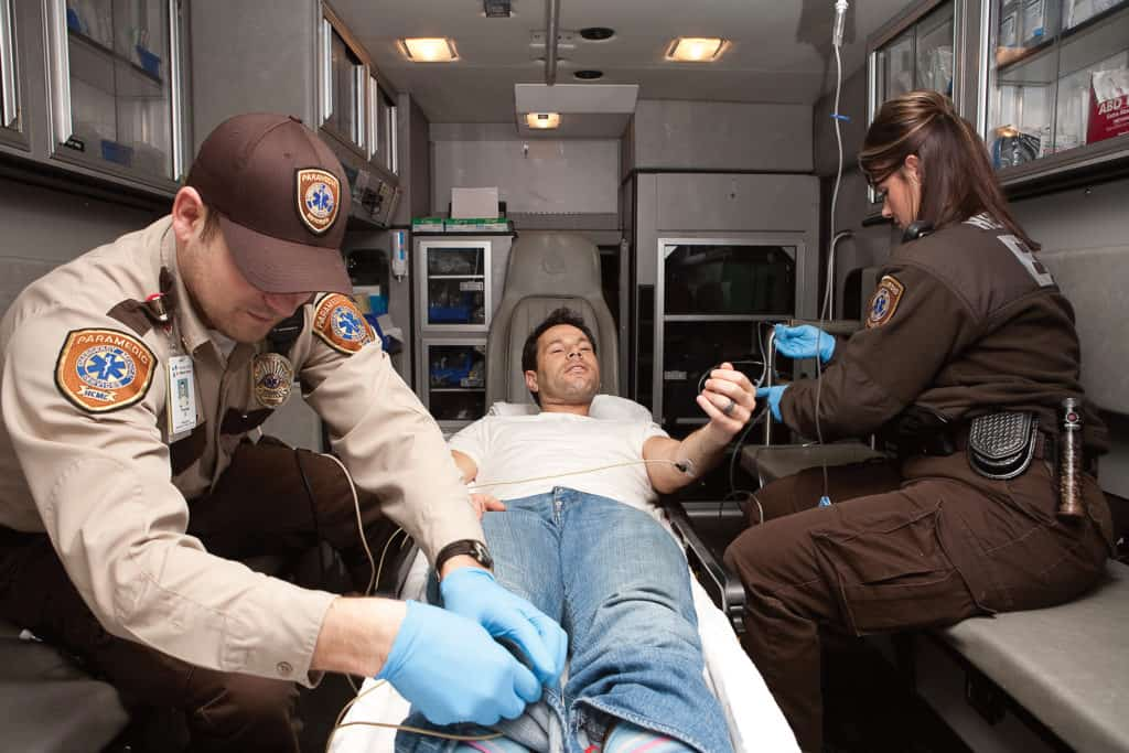 paramedics in ambulance with patient