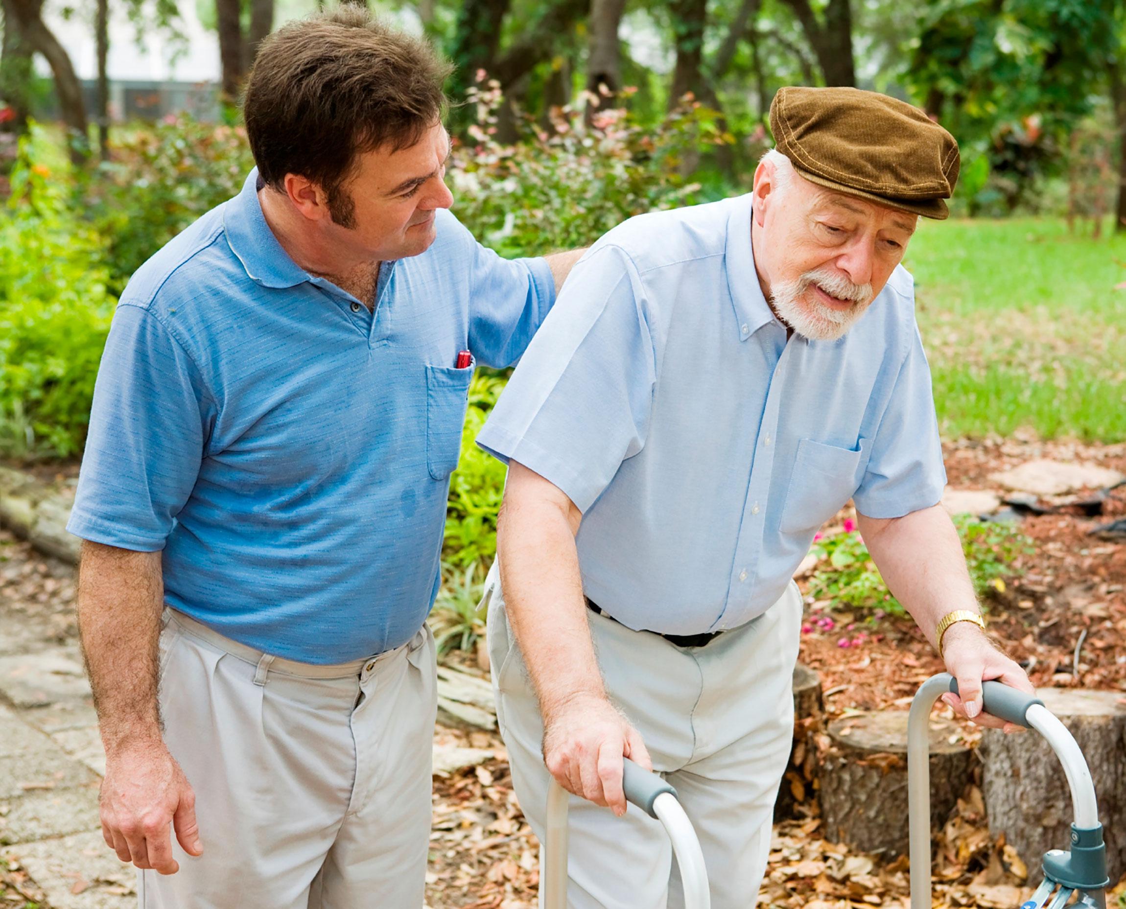 male nurse senior walking