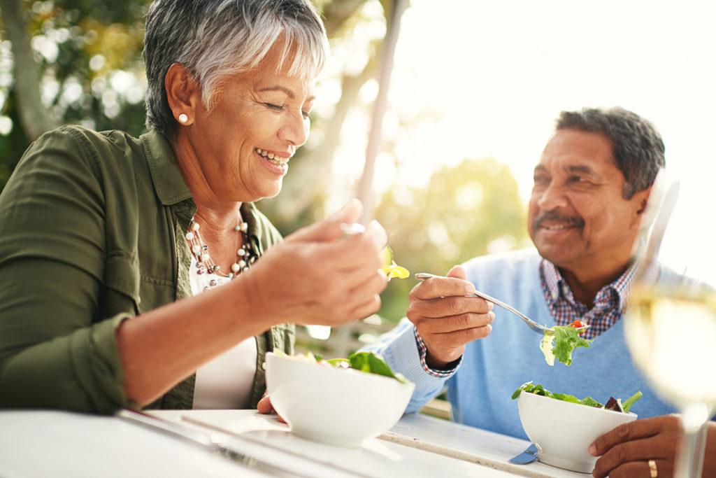 older couple eating salads