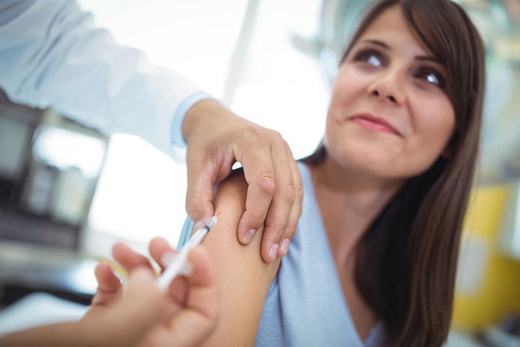 female patient getting flu shot