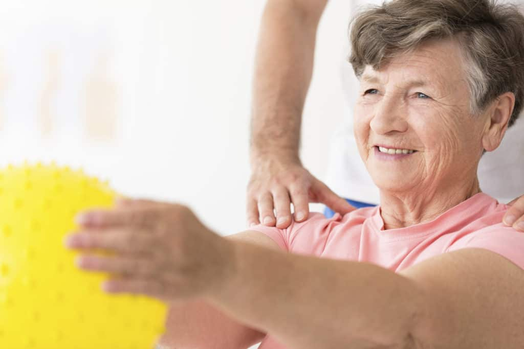 older woman in physical therapy clinic