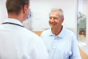 older man consulting with doctor