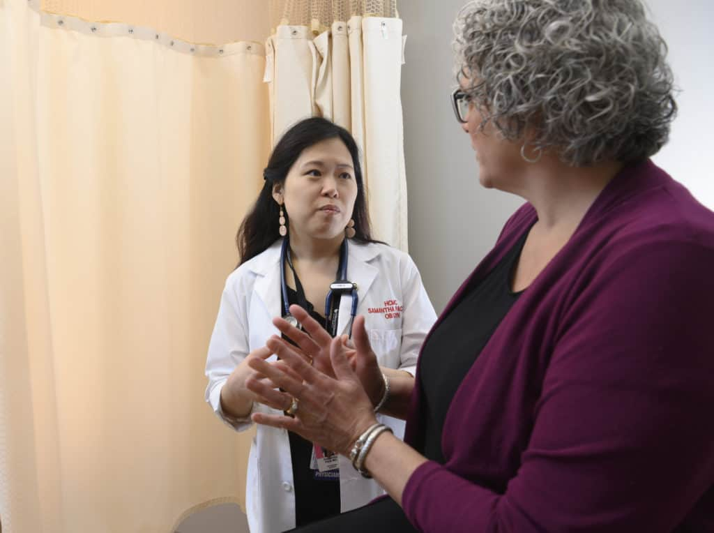 women's health doc with patient in clinic