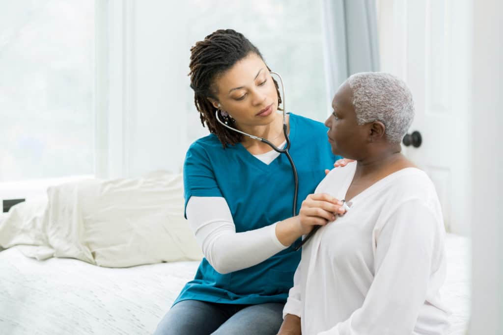 home health nurse with patient