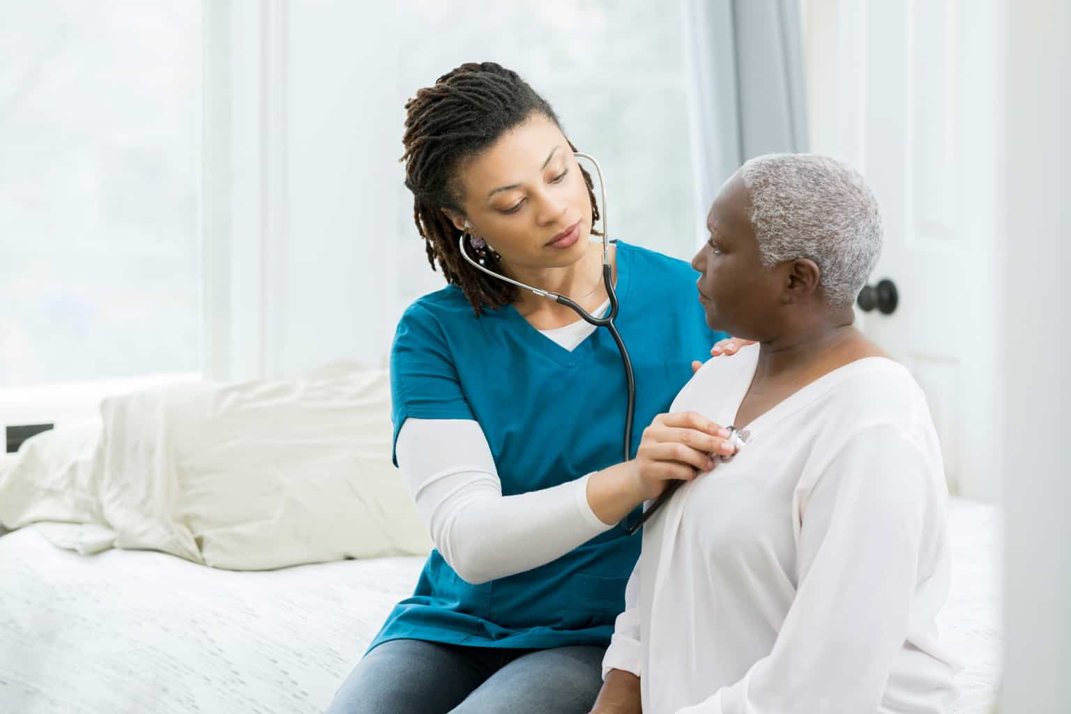 home health nurse with patient