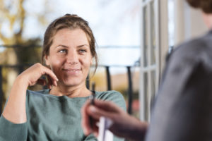 woman smiling in clinic