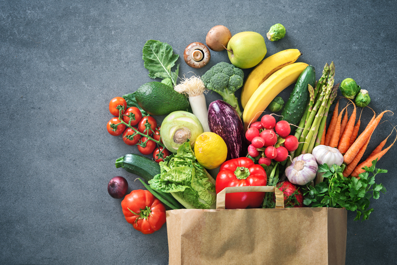 healthy produce sprawling from grocery bag