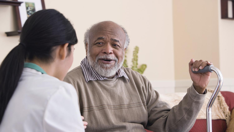elderly african american man with nurse