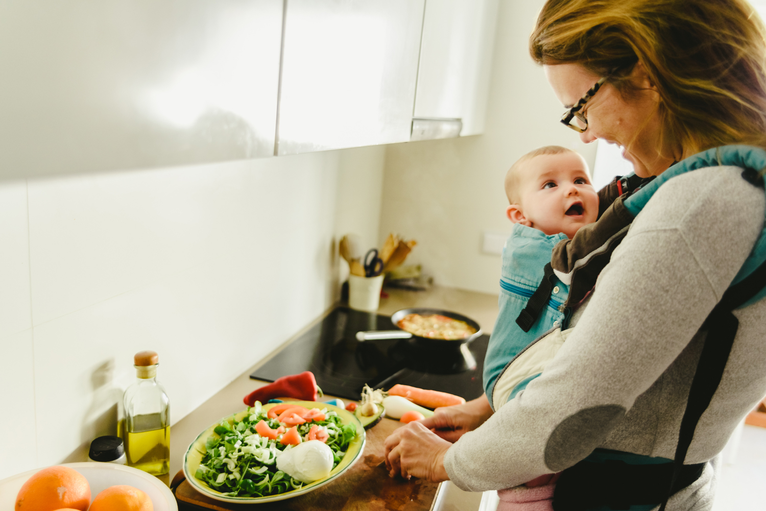 mom with baby preparing meal
