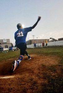 JC jumping for joy on baseball field